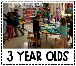 Image shows many students playing and learning in a classroom decorated for Christmas. Text reads 3 Year Olds