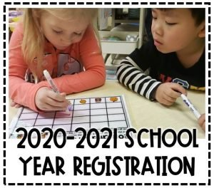 Image of two students working at the table. Text reads 2020-2021 School Year Registration